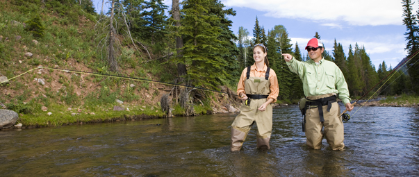 Two people fly fishing.